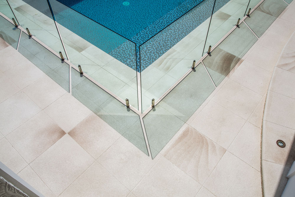 Pool surrounds completed using Stylepave in an Augustan Stone pattern with CCS Ocean Sand and CCS Almond
