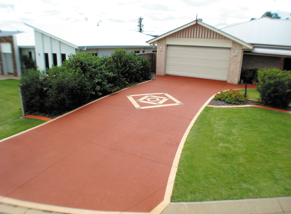 Updated driveway with custom design in the middle