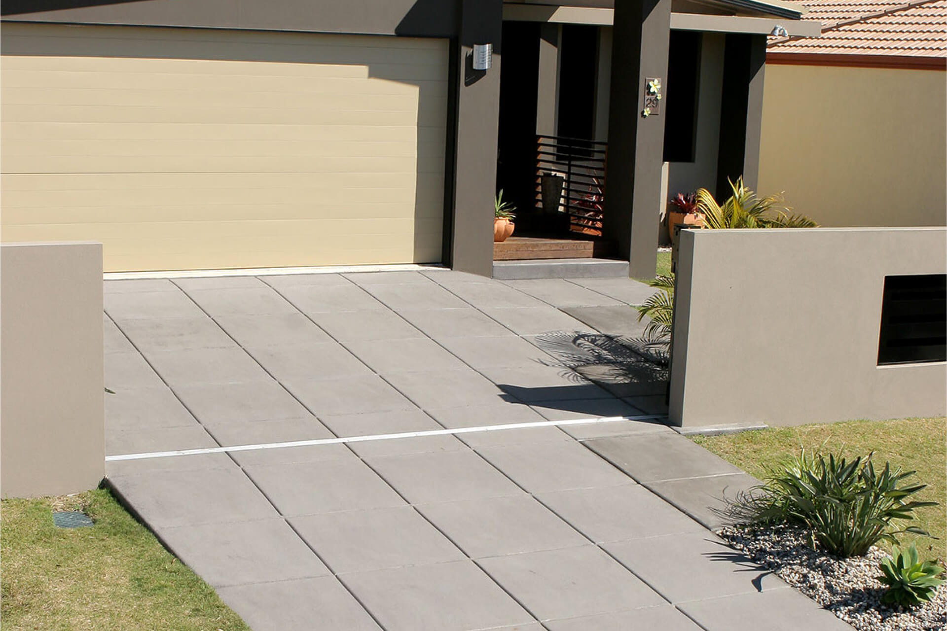 Residential driveway project using CCS Walnut with saw cuts or grooved lines